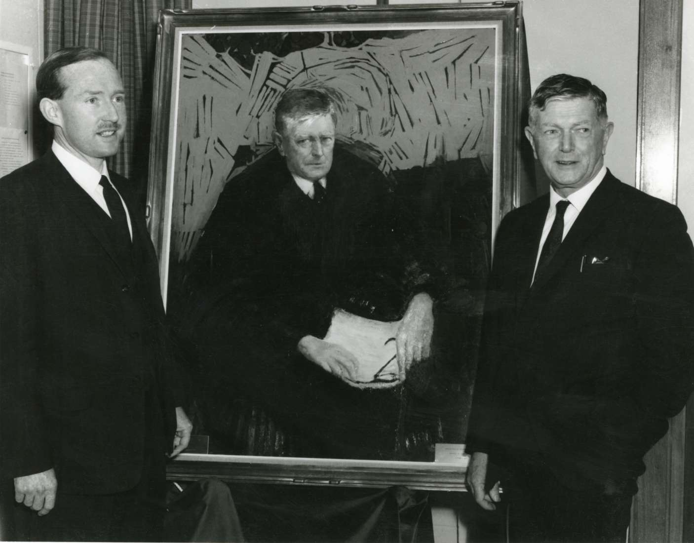 Sir Andrew Grimwade and Sir Frank Macfarlane Burnet pictured with a portrait of Burnet, painted by Clifton Pugh.