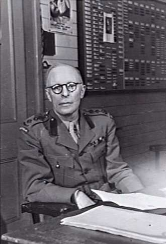 EV Keogh photographed at his desk at Victoria Barracks
