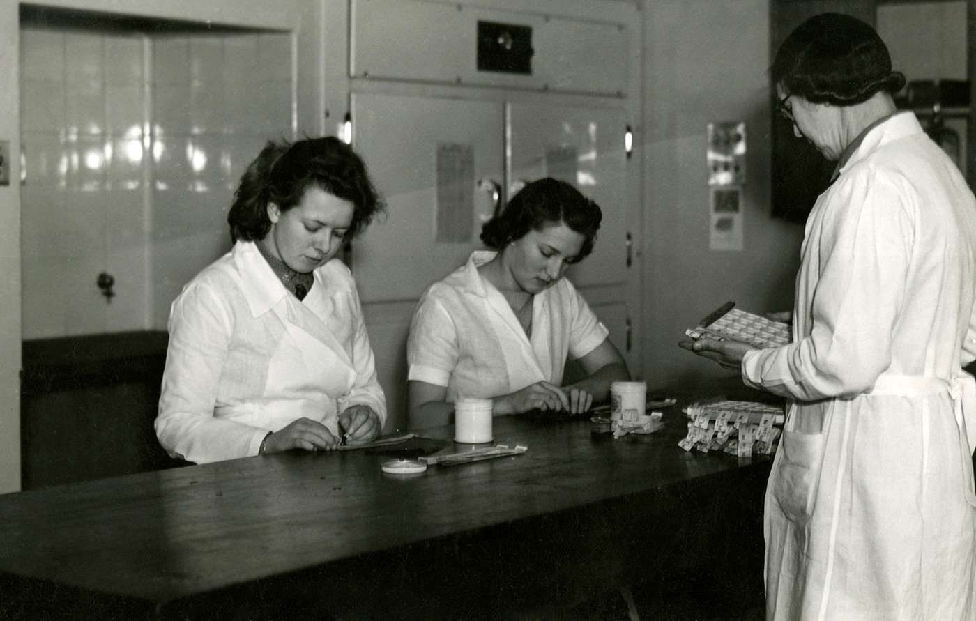 Fannie Williams and two other staff members performing blood grouping work.