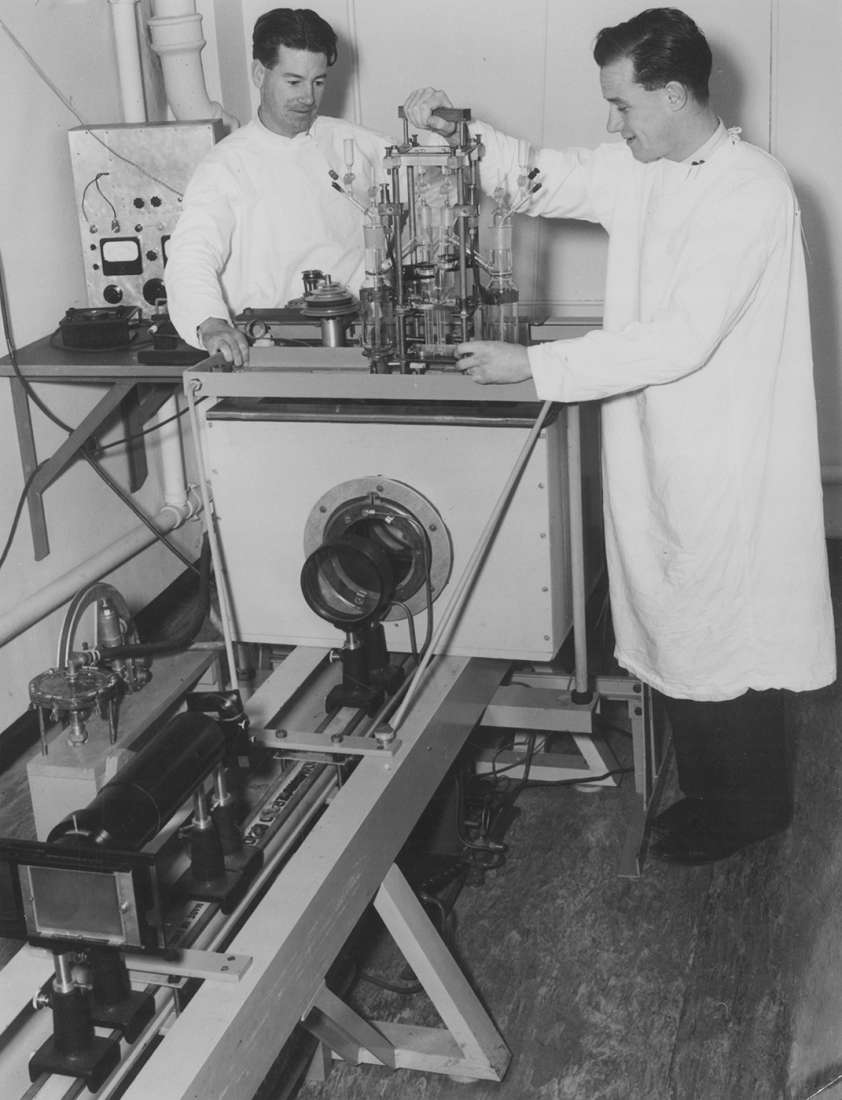 Gordon Leslie Ada and John Pye using research equipment.