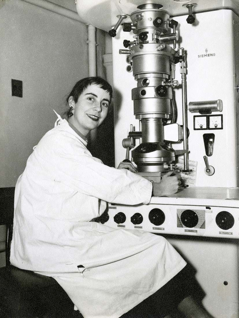 Photograph of Dr Heather Donald sitting at an electron microscope