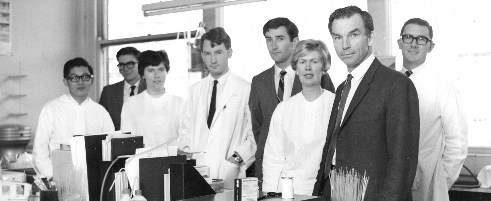 Group photo of the Clinical Research Unit. From left to right: C Yap, John Mathews, Mrs Merrill Rowley, P Thompson, Vance Gledhill, Senga Whittingham, Ian Mackay and Alex McPherson.