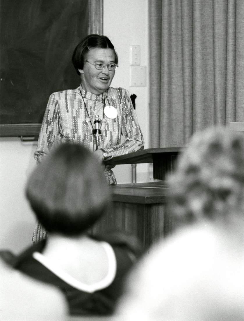 Black and white photograph of Dr Margaret Holmes delivering a talk.