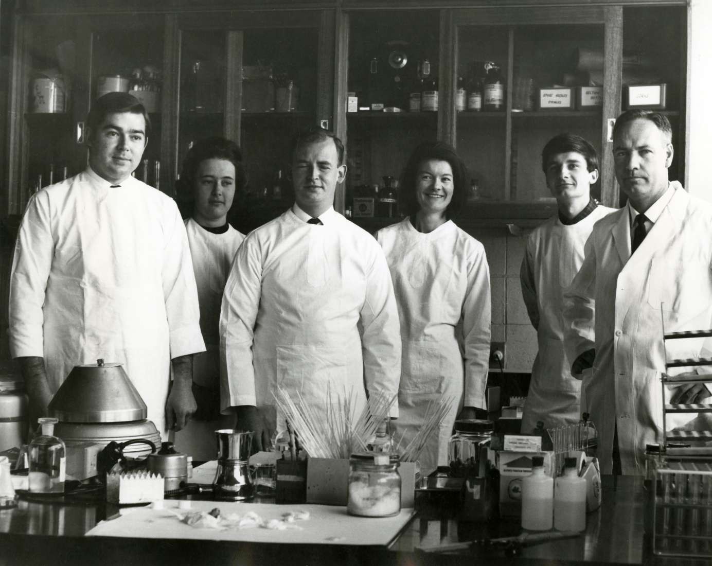 Black and white photo of six members of staff from the institute's cancer research unit, including Don Metcalf.