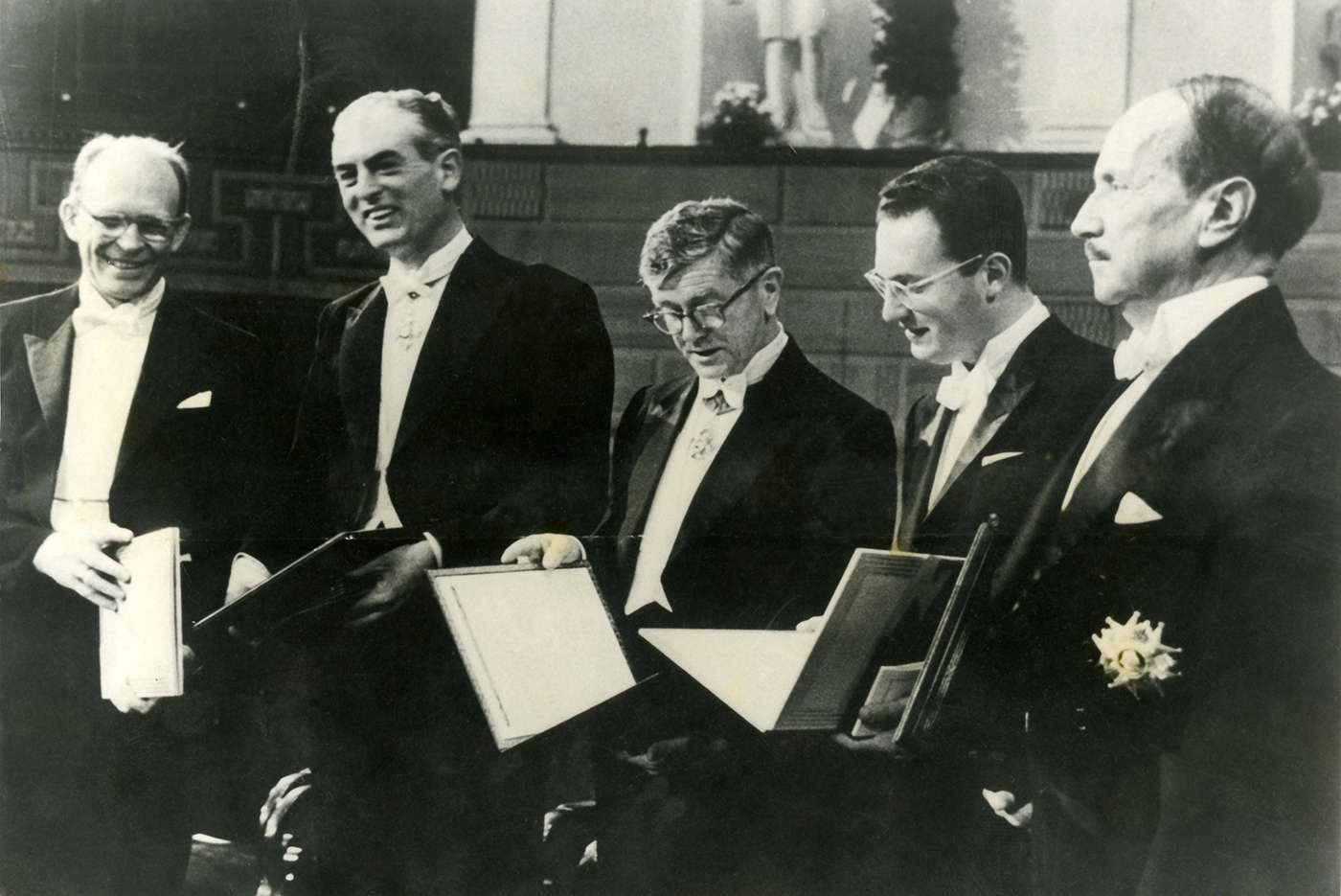 Five Nobel Prize winners, including Sir Frank Macfarlane Burnet, photographed together after receiving their awards.